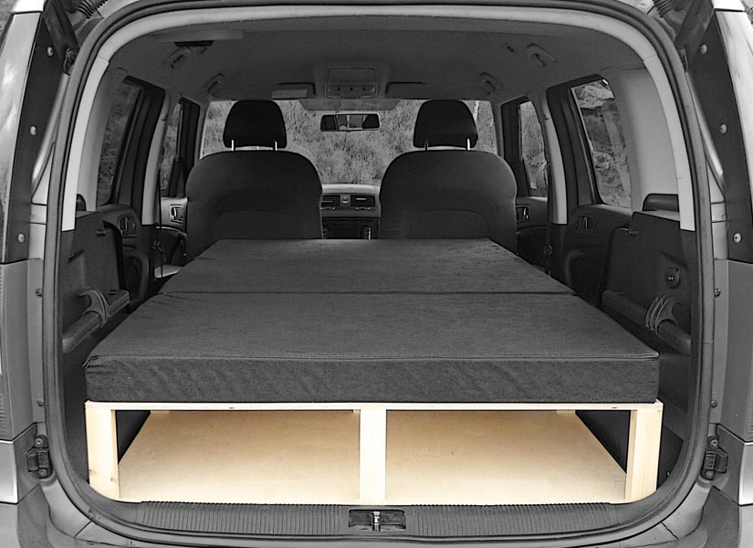 The Skoda Yeti camper van conversion in sleeping mode with the optional cushion set.
